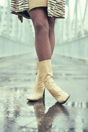 Woman Wearing White Boots